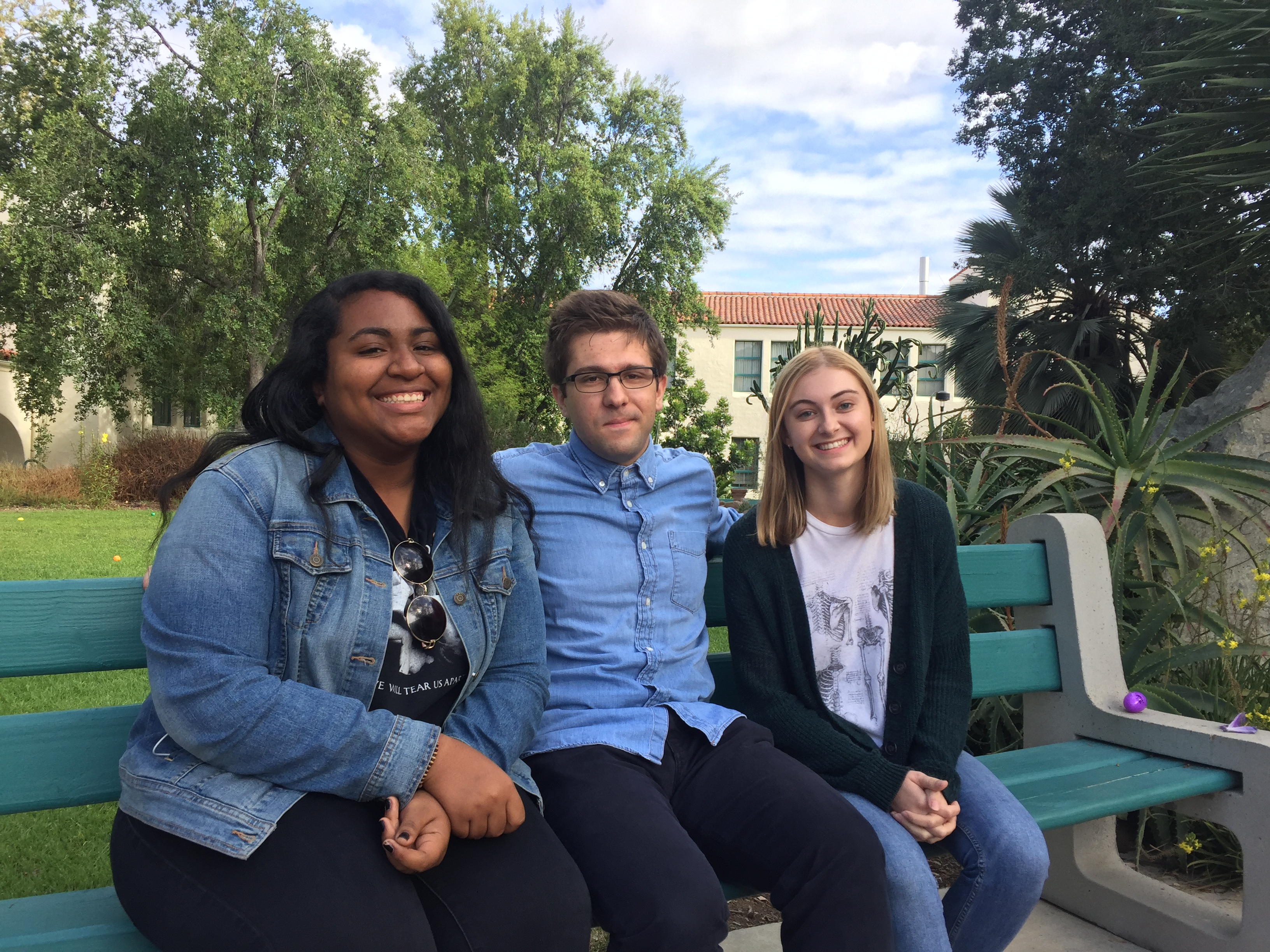 Caitlin, Nick and Alicia sitting in a courtyard at SDSU.