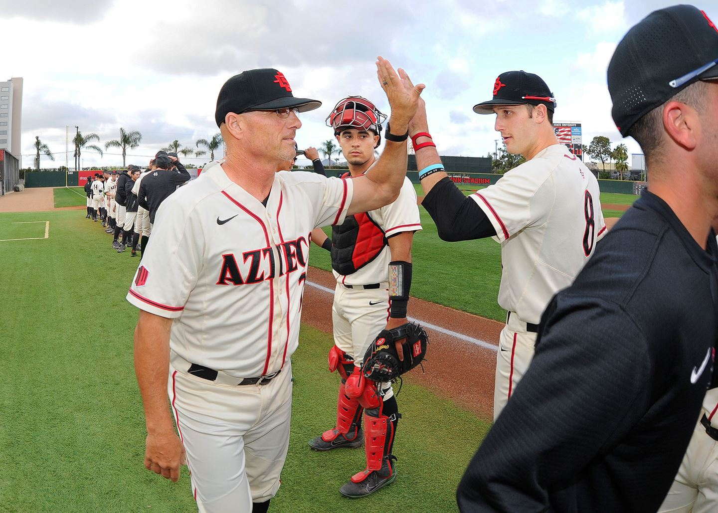 aztecs baseball high five