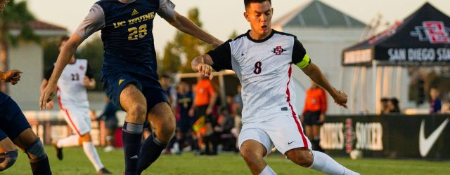 Senior Midfielder Pablo Pelaez kicks the ball against a UC Irvine defender