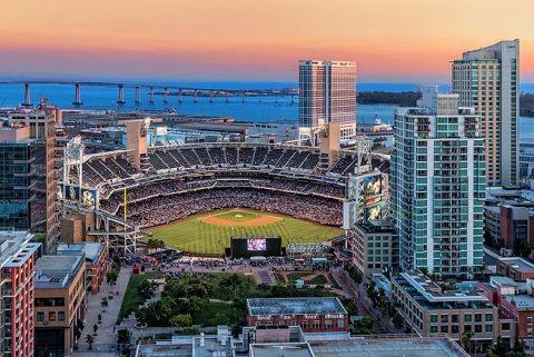Panoramic view of Petco Park in East Village with a sunset backdrop