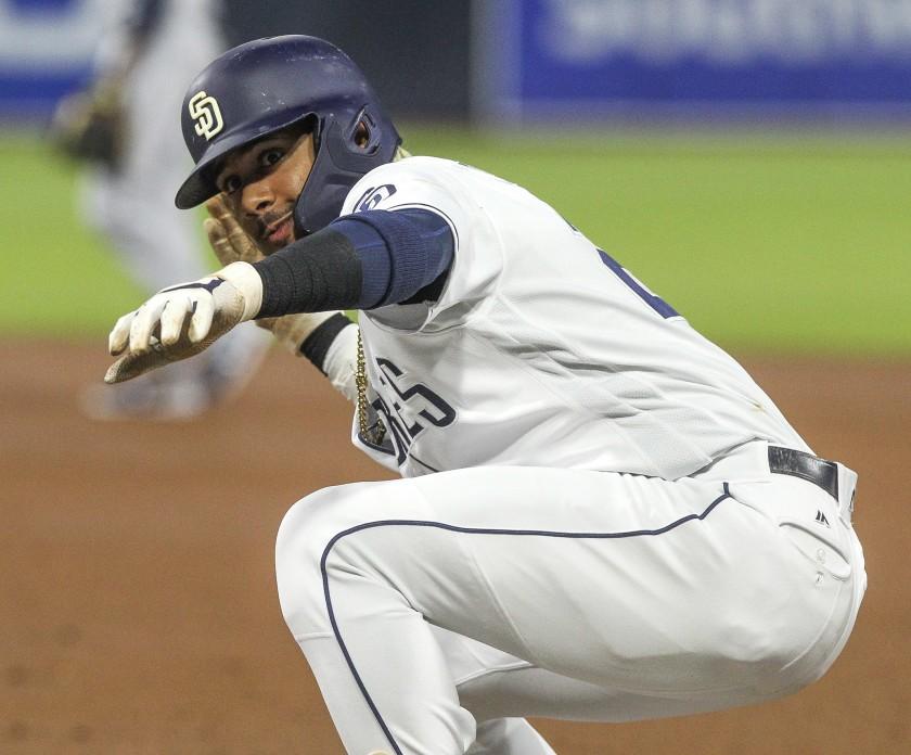 Padres shortstop Tatis Jr. crouching down